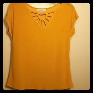 Yellow blouse with cut out pattern